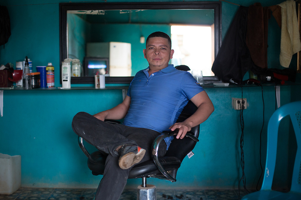 Rubén Dario Martinez, 28, Santa Cruz, Catacamas, Olancho<br /> <br /> I learnt to be a barber from nothing, I didn't know anything about it, learnt it all from the LWF training, building up a clientele. It's better than working as a security guard, like before. I'd earn less than half of the national minimum wage, and the work was all night, it was dangerous. I worked in a hotel, where all sorts of people go, if you know what I mean, this is a dangerous city. One time a client was drunk and wanted me to drink with him, I said no and he but the barrel of his gun in my face and forced me to drink.<br /> <br /> I decided for reasons of security to try to get to the US. Also out of sheer poverty. When you're on the bottom rung, it's hard.<br /> <br /> I went on my own, no smuggler, didn't have the money to pay one. It was hard. Sometimes I didn't eat. Sometimes I met people with children, sometimes I'd help them carry their kids, it's hard to leave people behind struggling, it's hard. Sometimes people tried to rob us. Sometimes people would insult me.<br /> I got to Mexico City. That's where I was caught. I spent two weeks in prison in Mexico, it was full of Hondurans, Guatemalans, Salvadoreans. <br /> <br /> No one likes to leave their family on their own. <br /> <br /> Rubén looks after his younger brother who has Downs Syndrome.<br /> <br /> LWF's program for returned and deported migrants is supported by ELCA.