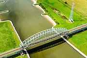 Nederland, Gelderland, Gemeente Arnhem, 26-06-2013; dubbelsporige stalen spoorbrug over de Neder-rijn. Spoorwegverbinding tussen Arnhem en  richting Nijmegen.<br /> Railway bridge over river Rhine west of Arnhem.<br /> luchtfoto (toeslag op standaard tarieven);<br /> aerial photo (additional fee required);<br /> copyright foto/photo Siebe Swart.