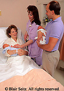 Medical, Maternity Room, Hospital, Mother, Father, Nurse and Twin Babies