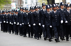 © Licensed to London News Pictures.10/04/2017.London, UK. Police officers in No.1 Dress uniform line the streets around Southwark Cathedral in London where the funeral of PC Keith Palmer is due to take place this afternoon (Mon). PC Palmer was murdered just inside the gate by Westminster attacker Khalid Masood - an attack in which he also killed four people on Westminster Bridge.Photo credit: Tom Nicholson/LNP