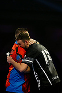 Ross Smith congratulates Daryl Gurney during the Darts World Championship 2018 at Alexandra Palace, London, United Kingdom on 18 December 2018.