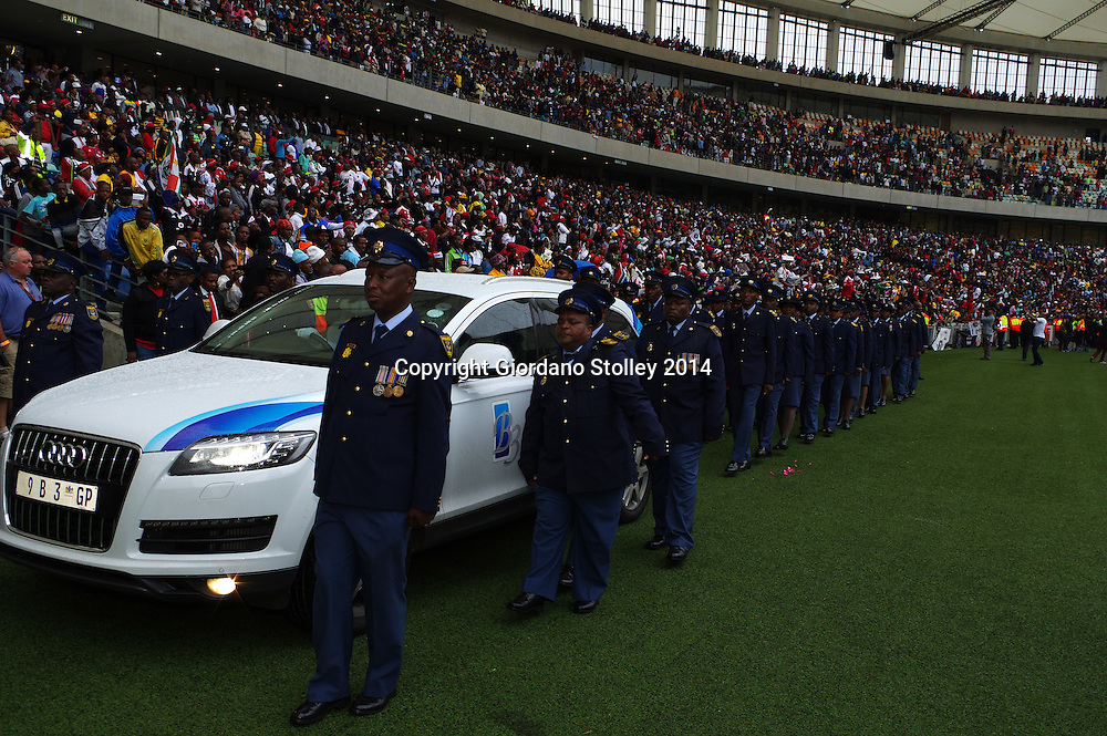DURBAN - 1 November 2014 - An honour guard of the South African Police Services escortsd the hearse carrying the coffin of South African soccer captain Senzo Meyiwa out of Durban's Moses Mabhida Stadium. Meyiwa, who was also the goal keeper for Orlando Pirates, was gunned down in Vosloorus, Gauteng, a week earlier. while visiting his girlfriend's house during a robbery. Picture: Allied Picture Press/APP