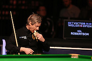 Neil Robertson of Australia eats a banana during his match against China's Ding Junhui. Betvictor Welsh Open snooker 2016, day 5 at the Motorpoint Arena in Cardiff, South Wales on Friday 19th Feb 2016.  <br /> pic by Andrew Orchard, Andrew Orchard sports photography.