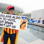 A Spanish activist campaigns in front of the Scottish Parliament for an independent Catalonia.<br />  Scottish referendum in Edinburgh. All through out the day a huge number of voters turned out asll over Scotland to vote in the independence referendum. The polls were open from 7am till 10pm and the count went on through-out the night with the final results announced early in the following morning.