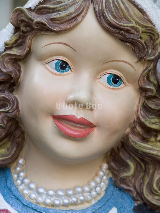Close up of a traditional dressed Dutch flower girl display doll