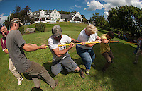 Anchors Bob McKinney and Bo Dunham, Michael Chandronnait, Liz Pomeroy and Jesse Padgett compete in a tug-of-war contest at the Taylor Home during Staff Appreciation Week on Friday afternoon.  (Karen Bobotas/for the Laconia Daily Sun)