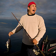 Jordin Tootoo grew up in a small village along the Hudson Bay only a hundred miles from the Arctic Circle. The first Inuit to play professionally in the National Hockey League, Tootoo spends his offseason at home where he fishes and hunts for Caribou, seal and Beluga whale. Living off the land is necessary for residents of the small village.<br /> <br /> Image available for licensing and for a personal print. Please Add To Cart and select the size and finish. All prints are delivered directly to you from the printer.