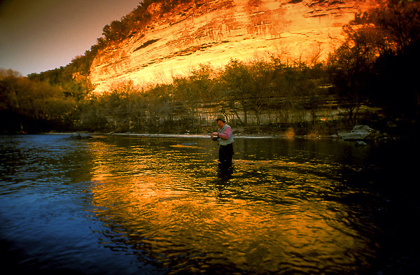 Stock photo of a man fly fishing in a Texas hill country river