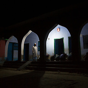 CAPTION: At Bara's madrasa (Islamic educational institution), evening study sessions can continue without interuption even after dark, thanks to reliable power flows from DESI Power. LOCATION: Bara, Araria District, Bihar, India. INDIVIDUAL(S) PHOTOGRAPHED: Kari Abdul Salaam and madrasa students (faces not shown).