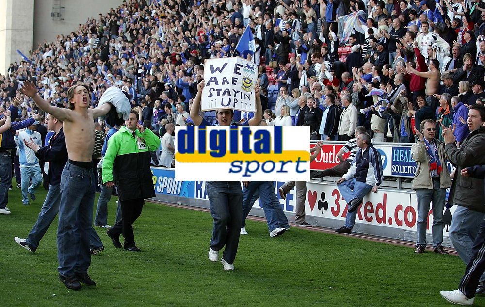 Photo: Paul Thomas.<br /> Wigan Athletic v Portsmouth. The Barclays Premiership. 29/04/2006.<br /> <br /> Portsmouth fans invade the pitch at the end.
