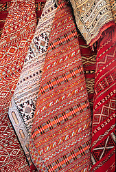 Africa, Morocco, Ouarzazate, Woven kilim tapestries hanging in market.