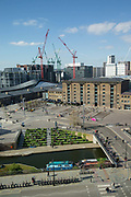 An elevated view across Regents Canal towards Central Saint Martins college in Granary Square with new building developments in the background on the 10th April 2019 in London in the United Kingdom.