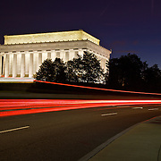 Daybreak in near empty Washington when the night lights of the monuments are still on and a new day is about to rise. The Lincoln Memorial honors the 16th President of the United States. Located on the National Mall in Washington, DC, the monument contains a large seated sculpture of Abraham Lincoln and inscriptions of two well-known speeches by Lincoln, The Gettysburg Address and his Second Inaugural Address.