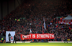 Liverpool fans in the stands with a Unity is Strength banner during the Premier League match at Anfield, Liverpool.