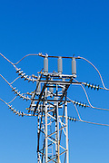 High voltage three phase electricity power lines and insulators on a metal tower in a urban substation <br /> <br /> Editions:- Open Edition Print / Stock Image
