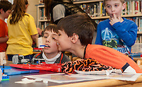 "Ryan Poliquin and Trevor River get right up close to view their Lego ""flip book"" as it makes their fish appear in the fishbowl during Elm Street School's ""Let Go Your Mind"" with Angela Stafford Tuesday afternoon.   (Karen Bobotas/for the Laconia Daily Sun)"