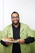 Queens, NY - December 12, 2017: Chef Albert Teekasingh of Tropical Revival in Whitestone, serving Guyanese, Island and Southern American food.  <br /> <br /> <br /> CREDIT: Clay Williams for Edible Queens.