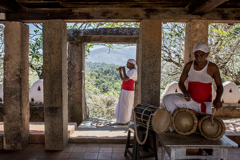 Kristi, on flute, and Marasingha, on drums, play music before the daily offering to Buddha. Lankathilaka is an ancient Buddhist temple built in the 14th century. Udunuwara of Kandy, Sri Lanka