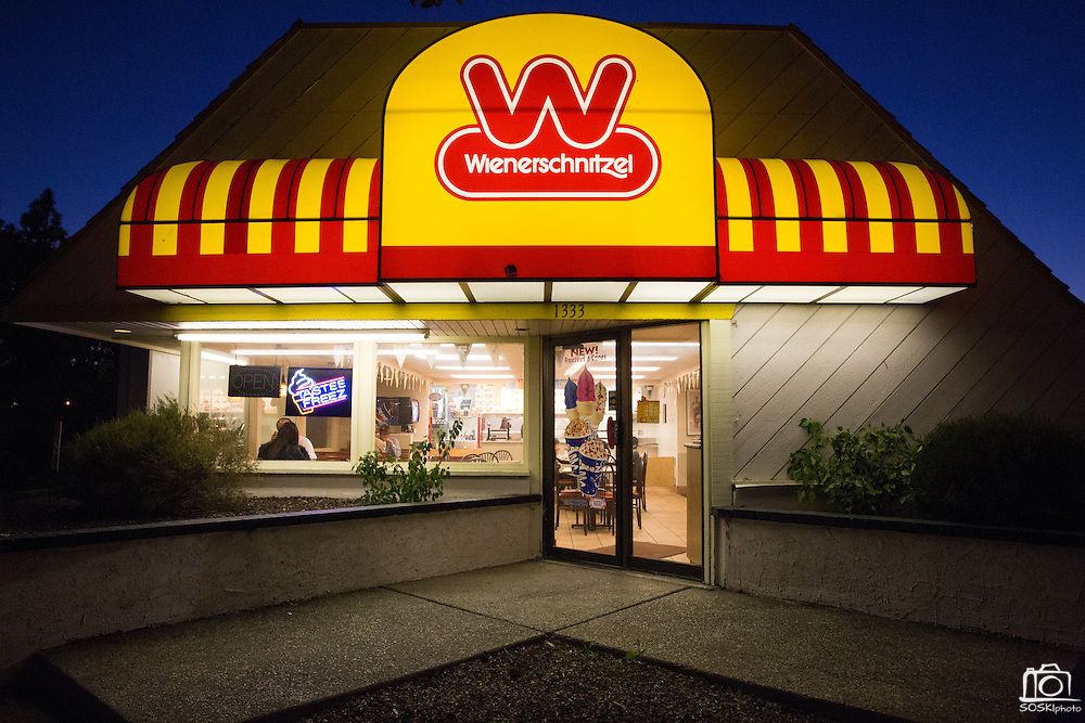 Guests dine on corn dogs, chili cheese fries, and ice cream during twilight at Wienerschnitzel in Milpitas, California, on February 22, 2014.  The S. Park Victoria Dr. location is closing its doors after 17 years of service after the the stores lease was not renewed. (Stan Olszewski/SOSKIphoto)