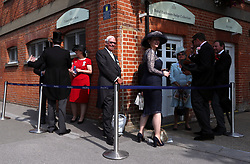 Racegoers arrive at the Royal Enclosure badge collection queue during day two of Royal Ascot at Ascot Racecourse.