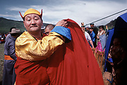 The High Lama speak at a ceremony near Khovsgol Lake.<br /> More than a hundred people traveled by horse and foot to hear Mongolia's high Lama speak at a ceremony honoring the placement of the first stone for the Dayan Derkh monastery, which is currently being rebuilt in Khövsgöl Province. The original structure was destroyed in 1938 by Soviet purges.