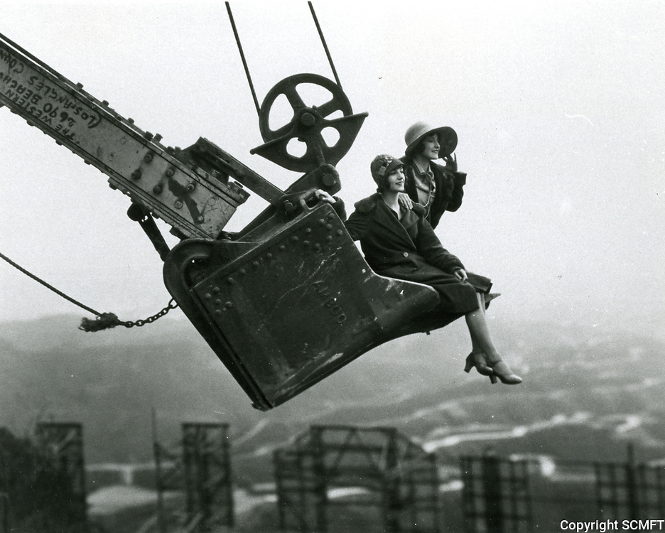 1924 Ladies in a steamshovel bucket behind the Hollywoodland sign