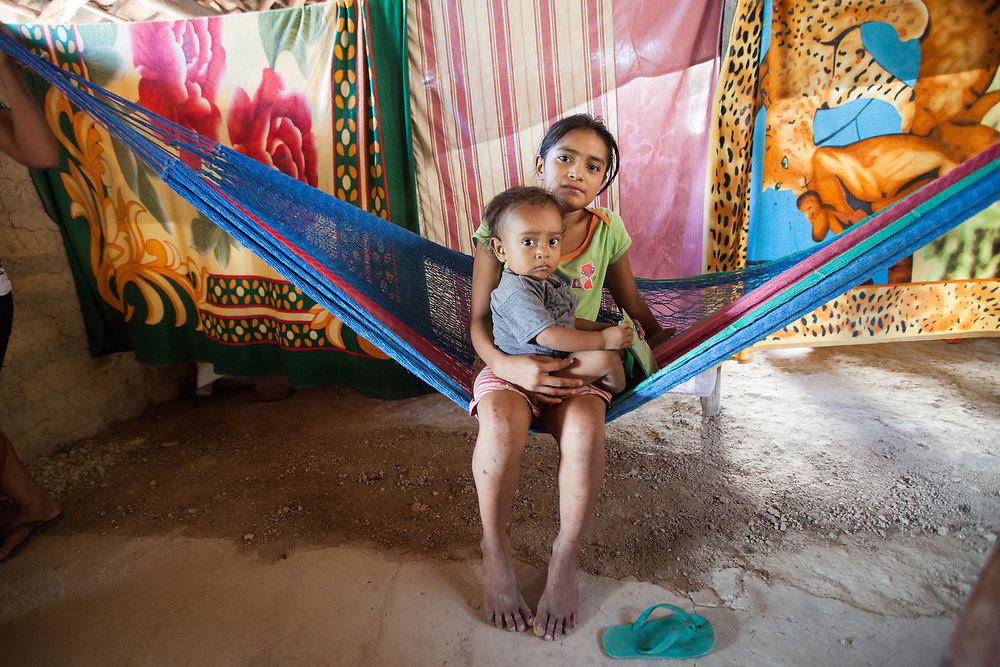 A young girl with a baby on a hammock in El Burillo village, Valle, Honduras.