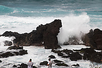 Tourists watching waves crashing over volcanic rocks at Hookipa Beach Park. From the beach overlook on the North Shore of Maui. Image taken with a Nikon D3x and 70-300 mm VR lens (ISO 100, 220 mm, f/9, 1/320 sec)