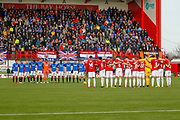 Both teams stand arm in arm and show their respect ahead of the Ladbrokes Scottish Premiership match between Hamilton Academical FC and Rangers at The Hope CBD Stadium, Hamilton, Scotland on 24 February 2019.