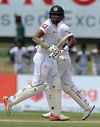 July 19, 2018 - Colombo, Sri Lanka - Sri Lankan cricketers Dimuth Karunaratne  and Danushka Gunathilaka during the first day of the 2nd test cricket match between Sri Lanka and South Africa at SSC International Cricket ground, Colombo, Sri Lanka on Friday 20 July 2018  (Credit Image: © Tharaka Basnayaka/NurPhoto via ZUMA Press)