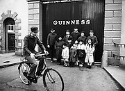 The Chieftains outside Guinness Brewery, St James's Gate, Dublin, meet with some Chinese children on tour.<br /> 21 February 1983