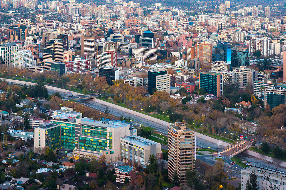 Santiago, Metropolitan Region, Chile - Panoramic view of Providencia district with Mapocho River and the snowed Andes mountain range in the back.