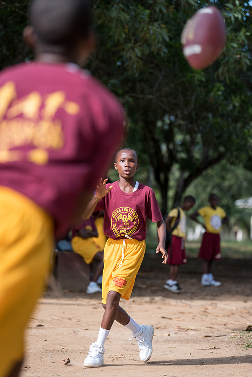 4 November 2019, Vriginia, Liberia: A group of students at Ricks Institute play football in the schoolyard. The Liberia Baptist Convention runs Ricks Institute, a day and boarding school for currently 496 students from kindergarten up through 12th grade.