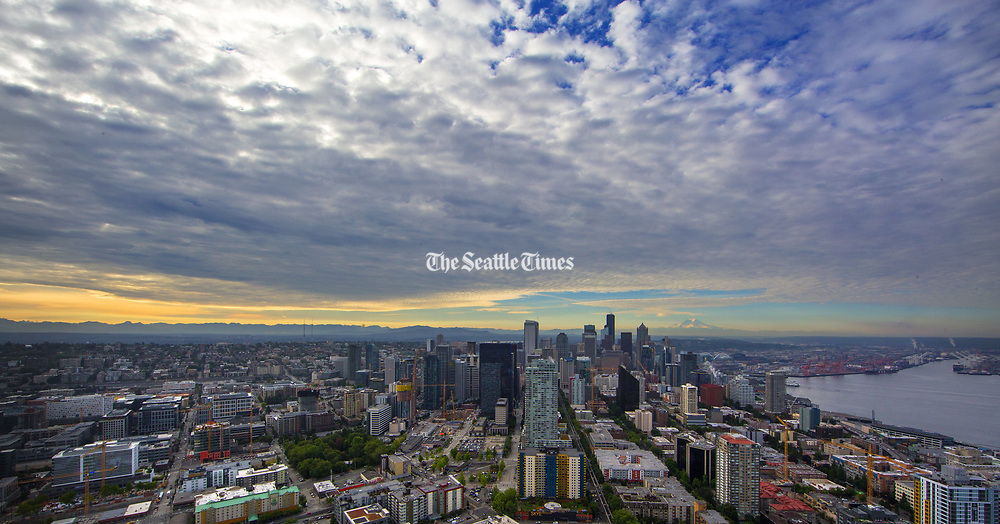 Mt. Rainier looms behind downtown Seattle. This view is from the Space Needle. (Mike Siegel / The Seattle Times)