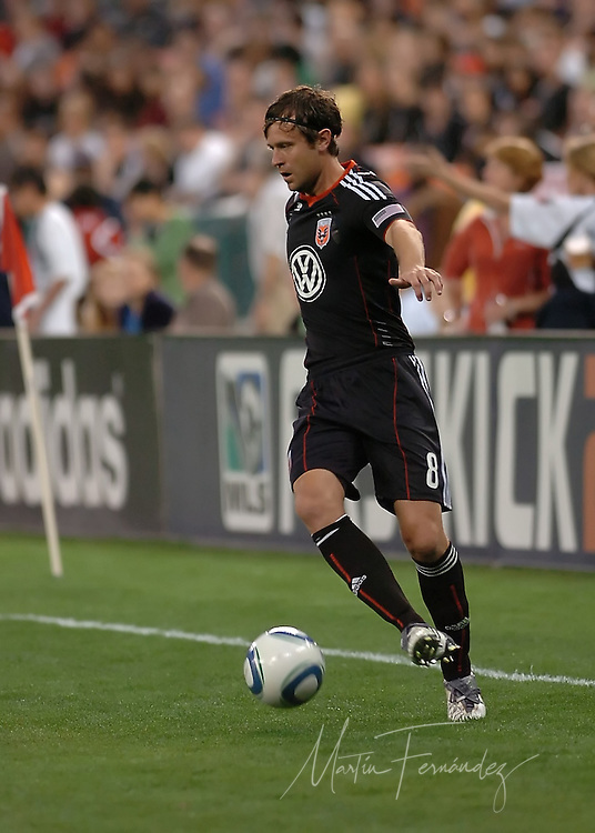 DC United defender Carey Talley controls the ball during his team's 2-0 loss in opening match to the visiting New England Revolution at RFK Stadium in Washington, D.C.