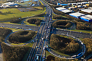 Nederland, Gelderland, Hoevelaken, 01-20-2011.Rijskweg A28 en de A1,.Bij knooppunt Hoevelaken is een file aan het ontstaan.  Bedrijventerrein De Hoef (rechtsboven)..The beginning of traffic jam at junction Hoevelaken..luchtfoto (toeslag), aerial photo (additional fee required) .copyright foto/photo Siebe Swart.