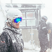 Josh Ehresman licks his lips completely encased in new storm Powder as he removes snow from the deck of Corbet's Cabin.