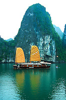 Orange Sail Junks on Halong Bay -Spending time on a Halong Bay junk you'll not only savor a unique feeling in a different world but you can also enjoy such activities as photography, fishing, kayaking, and even on-board cooking classes not to mention the UNESCO World Heritage views of Halong Bay itself.