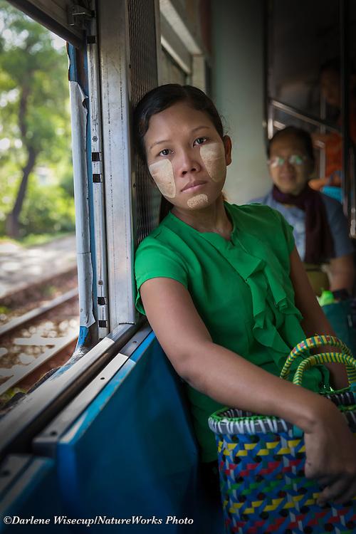 A woman travels on the Yangon Cirlcle Line train.  Yangon, Myanmar.