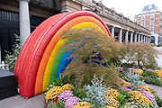Large inflatable rainbow in support of NHS and other key workers in Covent Garden on 13th August 2020 in London, United Kingdom. Coronavirus or Covid-19 is a respiratory illness that has not previously been seen in humans. While much or Europe has been placed into lockdown, the UK government has put in place more stringent rules as part of their long term strategy, and in particular social distancing.