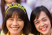 05 DECEMBER 2013 - BANGKOK, THAILAND: A woman wearing a hair band that says Long Live the King on the birthday of the King of Thailand. Thais observed the 86th birthday of Bhumibol Adulyadej, the King of Thailand, their revered King on Thursday. They held candlelight services throughout the country. The political protests that have gripped Bangkok were on hold for the day, although protestors did hold their own observances of the holiday. Thousands of people attended the government celebration of the day on Sanam Luang, the large public space next to the Grand Palace in Bangkok.     PHOTO BY JACK KURTZ