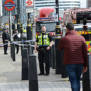 A fire at Westminster Station, two firefighting bridges seen outside and police, London, UK. 5 October 2021.