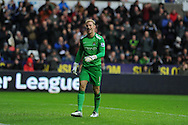Man city goalkeeper Joe Hart pulls a face as he sees funny side of a Wilfried Bony shot going inches wide of goal.  Barclays Premier league, Swansea city v Manchester City at the Liberty Stadium in Swansea,  South Wales on  New years day Wed 1st Jan 2014 <br /> pic by Andrew Orchard, Andrew Orchard sports photography.