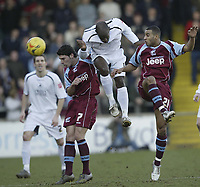 Photo: Aidan Ellis.<br /> Scunthorpe United v Swansea City. Coca Cola League 1. 18/02/2006.<br /> Swansea's Adrian Forbes gets in between Scunthorpe's Matt Sparrow and Marcus Williams to win the ball
