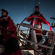 Leg 4, Melbourne to Hong Kong, day 02 on board MAPFRE, night picture, Pablo Arrarte stearing and Tamara echegoyen at the main sail sheet. Photo by Ugo Fonolla/Volvo Ocean Race. 03 January, 2018.
