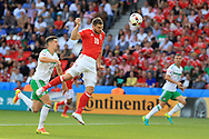 Sam Vokes of Wales heads wide of goal. UEFA Euro 2016, last 16 , Wales v Northern Ireland at the Parc des Princes in Paris, France on Saturday 25th June 2016, pic by  Andrew Orchard, Andrew Orchard sports photography.