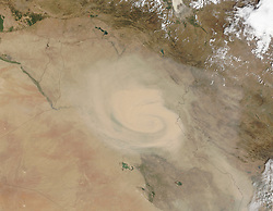 Dust and sand storms in the Middle East and other arid regions tend to come in two forms. Haboobs are dramatic events associated with storm fronts and often appear as walls of sand and dust marching across the landscape. But like thunderstorms, haboobs tend to abrupt and short-lived. Then there are the long-lived, wide-reaching dust storms that can last for days. In Iraq, such storms are often associated with the shamal, a pattern of persistent northwesterly winds.<br /> In early September 2015, a storm with characteristics of both the shamal and the haboob moved across Iraq, Iran, and the Persian Gulf region. The Moderate Resolution Imaging Spectroradiometer (MODIS) on NASA's Terra satellite captured these natural-color images of the dust storm on September 1 and September 3, 2015.<br /> The dust event first appeared in NASA satellite imagery along the Iraq–Syria border on August 31. By the next day, the storm took on the cyclonic shape visible in the top image above. By September 2, the dust cloud reached the Persian Gulf. It had spread out across the entire basin by the time of the September 3 image above.<br /> The storm appears to have been triggered by a surface low-pressure system that moved from northwest to southeast during the week. The cyclonic circulation around the center of low pressure is most obvious in the September 1 image. Weather data from ground stations in Baghdad, Khormor, and Al Asad confirm the wind circulation pattern. But the overall movement of the system from the northwest toward the Persian Gulf also suggests late-summer shamal winds.<br /> Much of northern Iraq has been in a state of exceptional drought. Anecdotal evidence and media reports in recent years suggest that dust storms have become more common in Iraq and Iran, a result of that drought and of the human and natural destruction of wetlands in the Tigris-Euphrates watersheds.<br /> News reports and social media chatter in September 2015 described wind gusts up to 80 kilometers 