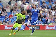 Cardiff City's Anthony Pilkington (r) controls the ball with his head while being watched by Reading's Liam Moore.  EFL Skybet championship match, Cardiff city v Reading at the Cardiff city stadium in Cardiff, South Wales on Saturday 27th August 2016.<br /> pic by Carl Robertson, Andrew Orchard sports photography.