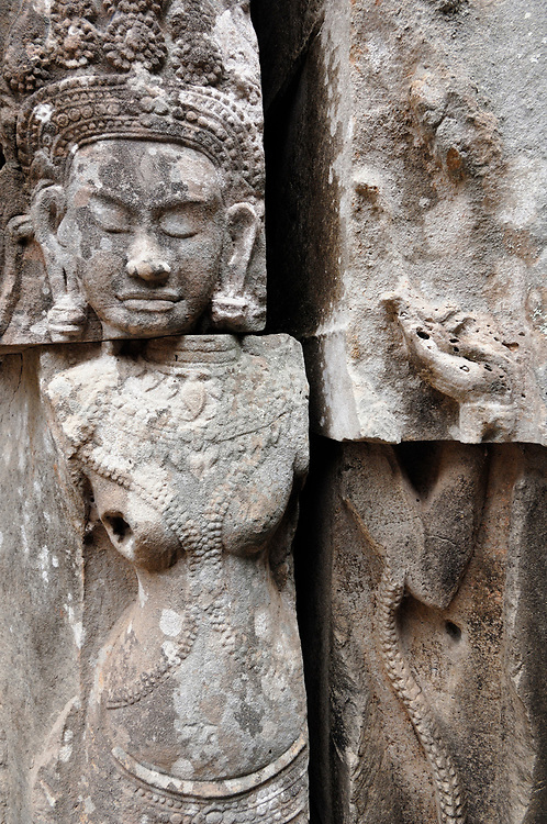 Detail of bas-relief sculpture in the Angkor Wat complex in Cambodia, which dates to the 12th Century.