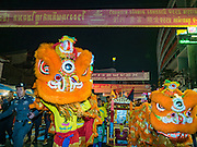 """07 FEBRUARY 2016 - BANGKOK, THAILAND: Traditional Chinese New Year lion dancers perform on Yaowarat Road in the heart of Bangkok's Chinatown.  Chinese New Year, also called Lunar New Year or Tet (in Vietnamese communities) starts Monday February 8. The coming year will be the """"Year of the Monkey."""" Thailand has the largest overseas Chinese population in the world; about 14 percent of Thais are of Chinese ancestry and some Chinese holidays, especially Chinese New Year, are widely celebrated in Thailand.        PHOTO BY JACK KURTZ"""